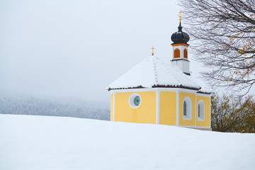 little church in Alps during winter