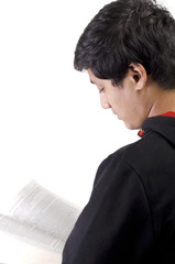 Side view of Asian student reading book