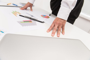 Closeup of businesswoman hands leaning on table.