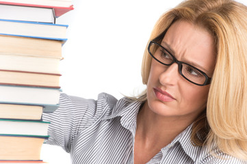 Portrait of confident female advocate looking at books.