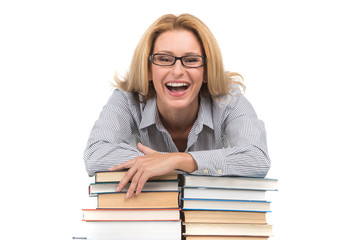 Portrait of happy female advocate leaning on books.
