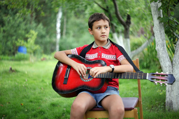 boy with the guitar outdoors