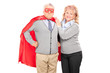 Mature lady posing next to her superhero husband