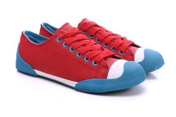 Pair of red sneakers on a white background