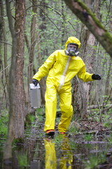 Technician in  uniform, suitcase  in contaminated   boggy area