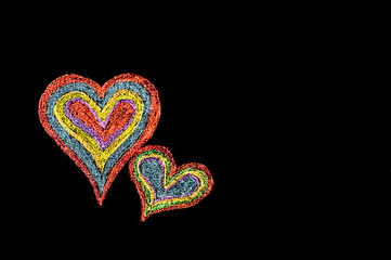 Conceptual image of love, with two vivid color shape hearts