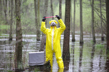 man in coveralls examining sample in contaminated area