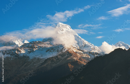 Foto Spatwand Nepal Himalayan snow mountain partly obscured by clouds