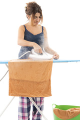Happy housewife ironing isolated on white background.