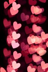 Defocused heart bokeh lights, abstract background