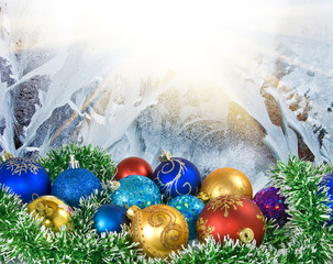 Image of Christmas balls on the winter patterns background