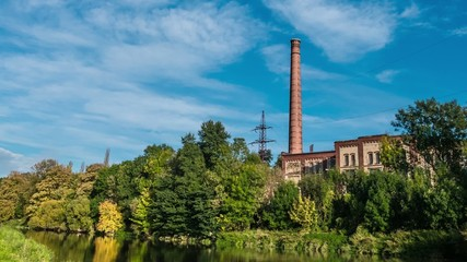 Time lapse old factory by the river.