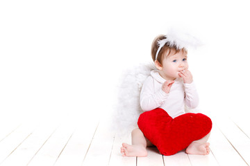 Little angel with red heart isolated on white.