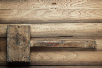 wooden hammer on the brown table
