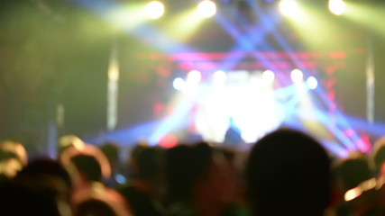 crowd at concert and stage lights defocused