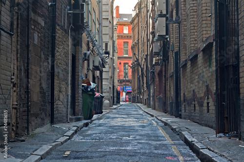 Looking down an empty inner city alleyway - 74481655
