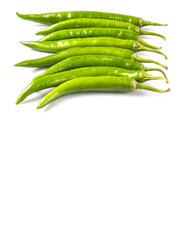 Green chili peppers over white background