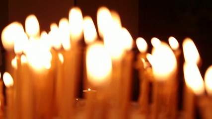 Burning candles in church altar Part I