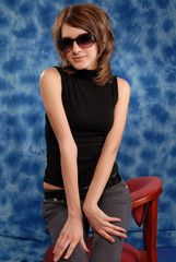 Girl posing on a blue background in studio