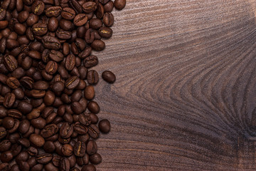 coffee beans on the brown wooden table