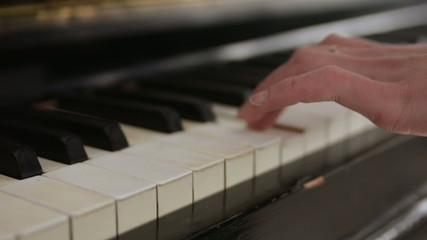 learning to play piano close up on hands tracking right