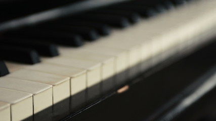 piano keys camera tracking right shallow depth of field