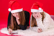 Girls surfing mobile under Christmas time