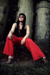 stylish girl in red pants and glasses
