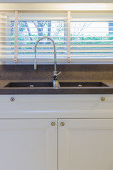 Water tap and sink in kitchen