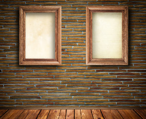 Two wooden frames on bricks wall.
