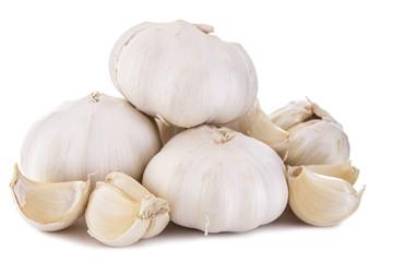Garlic. Three cloves of garlic arranged
