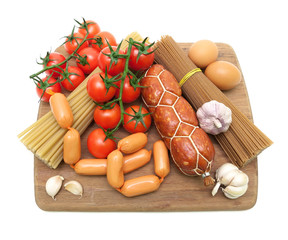 sausages, pasta, eggs and vegetables isolated on a white backgro