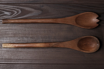 two wooden spoons on brown table