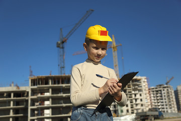 boy superintendent of building a new home