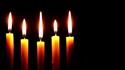 Five Candle on a Dark Background Time Lapse