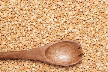 wooden spoon over peas background