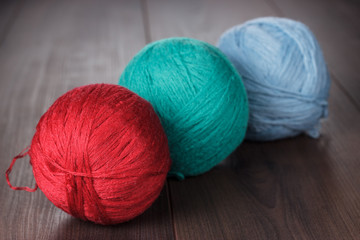 three knitting balls of threads