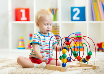 kid playing with educational toy indoor
