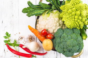 Vegetables on white rustic background.Veggies in cooking pot.