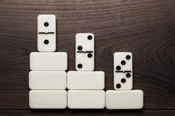 white domino pieces win concept background