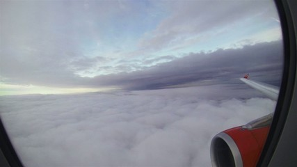 Time lapse, View out plane window to clouds