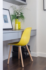 modern yellow chair with grey table