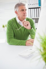 Casual businessman looking at computer screen