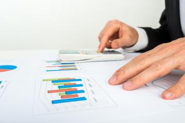 Businessman analysing a bar graph