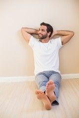 Happy man sitting on floor