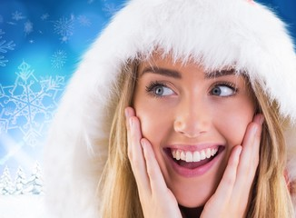 Composite image of pretty santa girl with hands on face