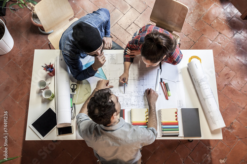 Leinwandbild Motiv Teamwork. Three young architects working on a project
