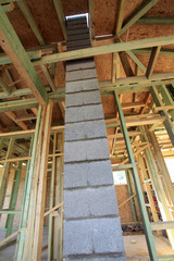 chimney of concrete blocks in unfinished wooden house