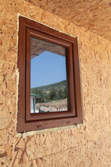 window at the new unfinished house