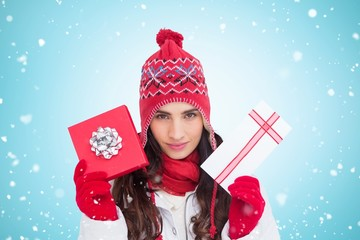 Festive brunette in winter clothes showing gifts